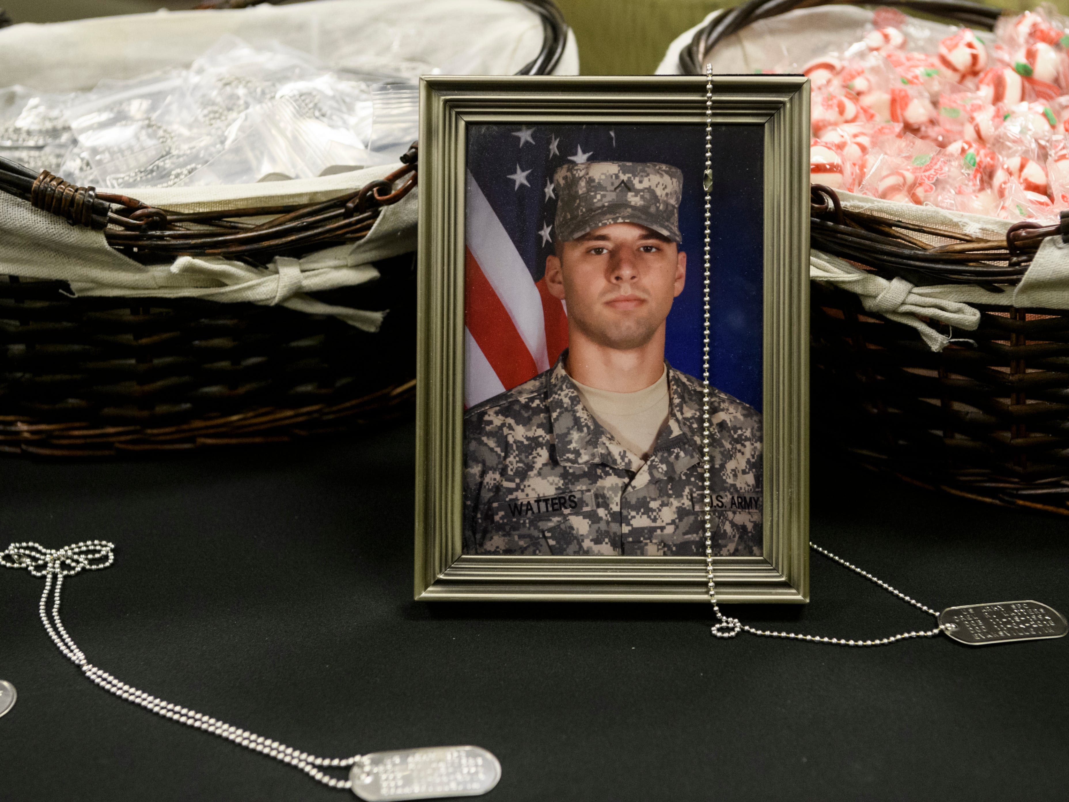 Commemorative dog tags sit out for people to take at the visitation for U.S. Army Sgt. Drew Watters inside Evansville's Christian Fellowship Church, Tuesday afternoon, Nov. 13, 2018.