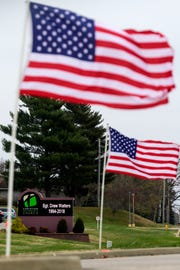 "Flags wave outside of Evansville's Christian Fellowship Church, where a visitation for U.S. Army Sgt. Drew Watters is held,Tuesday evening, Nov. 13, 2018. A ""Celebration of Life"" ceremony, including military honors, will be held inside the church at 2 p.m. Wednesday, Nov. 14."