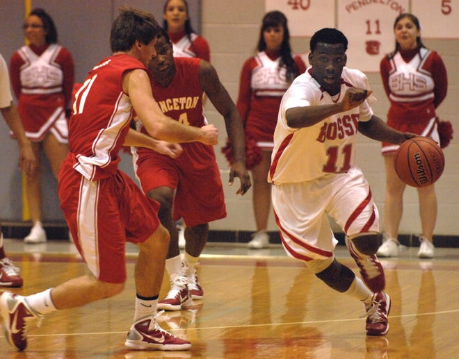 Bosse's Jalen Pendleton, (11) drives the ball as Princeton's Justin Simmons, (11) and Rontray Chavis, (34) look on in the first quarter of a 2011 game.