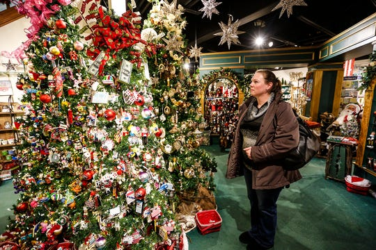 Stephanie Petzold, of Sheboygan, looks over Christmas ornaments during a recent visit to the Kristmas Kringle Shoppe, Ltd. in Fond du Lac, Wisconsin. The store sees many visitors from around the state.