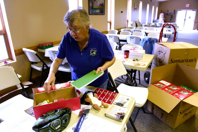 Jean Rhodes of Danbury, the drop-off coordinator for Samaritan's Purse Operation Christmas Child, collects donations at St. Paul Lutheran Church, 541 Church Rd., in Lakeside-Marblehead.
