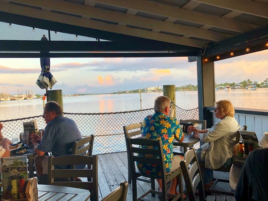 Dixie Fish Co. on Fort Myers beach offers stunning, overwater views of Matanzas Pass.