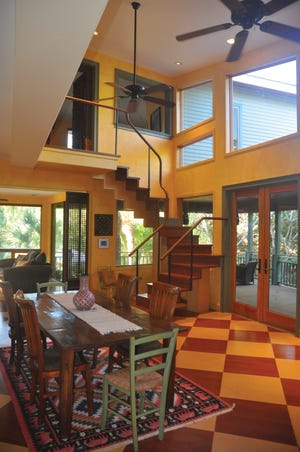 The inside the home is almost like being in a treehouse perched in the woods with lots of windows overlooking the woods and the pool.