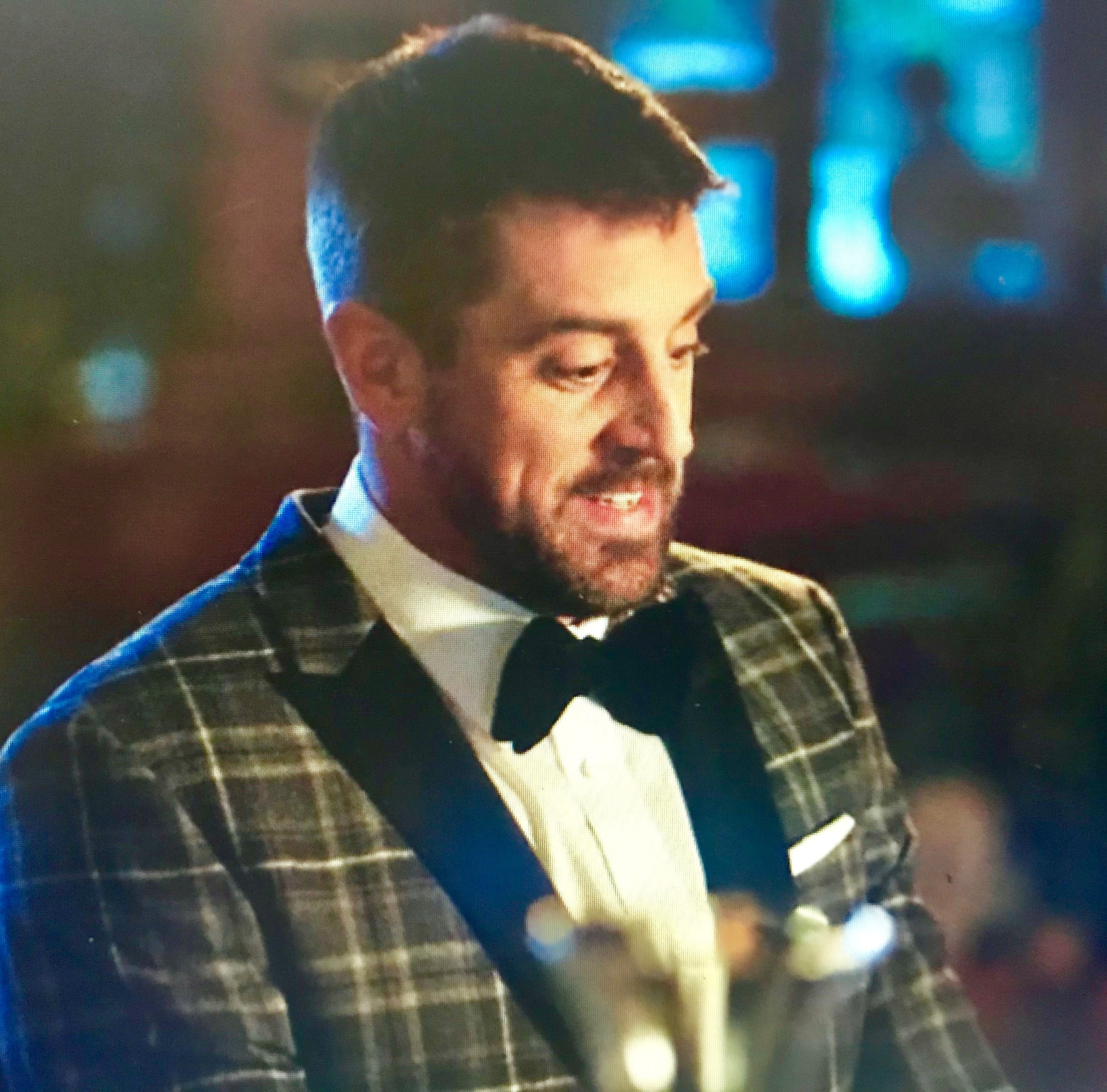Aaron Rodgers tickles the ivories in new holiday ad with Colin Jost for IZOD