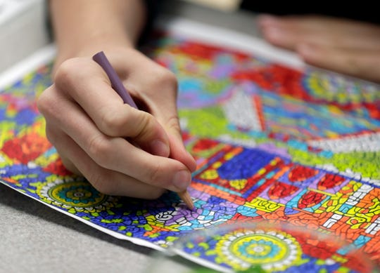ACE Teaching and Consulting student Will Sheppard, 14, colors a picture during socializing time Oct. 26, 2018 in Green Bay, Wis. Sarah Kloepping/USA TODAY NETWORK-Wisconsin
