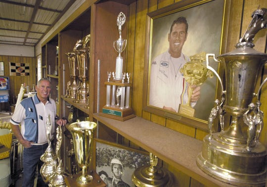 David Pearson stands with a few of his racing trophies in a building on his property in Spartanburg Friday, April 28, 2000. Pearson, the legendary NASCAR driver and Spartanburg native, died Monday, Nov. 12, 2018. He was 83.
