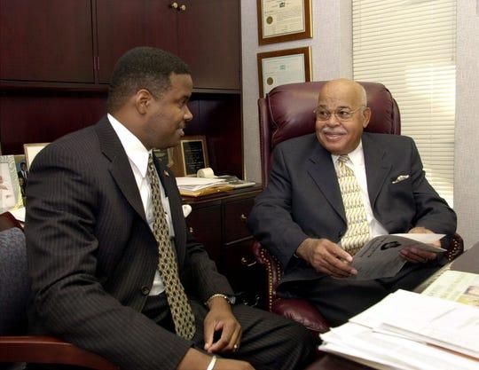 A 2000 photo of Fred Garrett (right) with his son, Fred Garrett Jr.