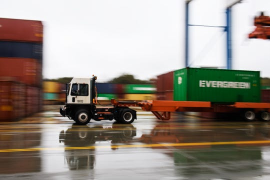 A truck navigates through the Inland Port Greer after it is loaded with a shipping container on Tuesday, Nov. 13, 2018.