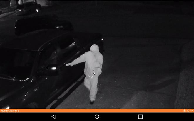 One of the two suspects caught on video surveillance breaking into a deputy's vehicle early Monday, Nov. 12, 2018.