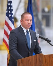 Judge Greg Pinski welcomes attendees to the fifth anniversary ceremony for the Veterans Treatment Court on Tuesday at the Montana Air National Guard.
