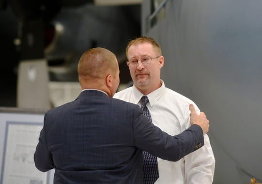 Judge Greg Pinski thanks Richard Cassels, a Marine Corps veteran, after Cassels delivered his story of recovery and transformation through the Veterans Treatment Court during the treatment court's fifth anniversary ceremony at the Montana Air National Guard, Tuesday.