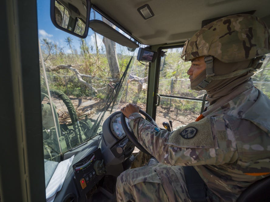 Guam Army National Guardsman Spc. Curtis Cruz, 1224th Engineer Support Company engineer, drives a loader during debris clean-up in the village of Susupe, Saipan, Commonwealth of the Northern Mariana Islands, Nov. 9, 2018, as part of the Super Typhoon Yutu relief effort.
