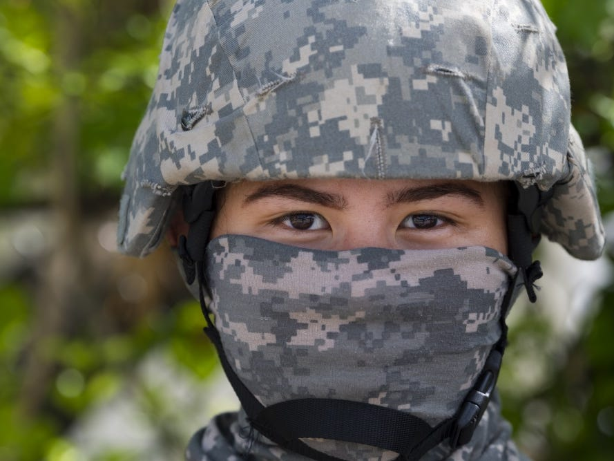 Guam Army National Guardsman Spc. Kelsie Sanchez, 1224th Engineer Support Company heavy equipment operator, takes part in an effort to clean debris as part of the Super Typhoon Yutu relief effort Nov. 9, 2018, on Saipan, Commonwealth of the Northern Mariana Islands.