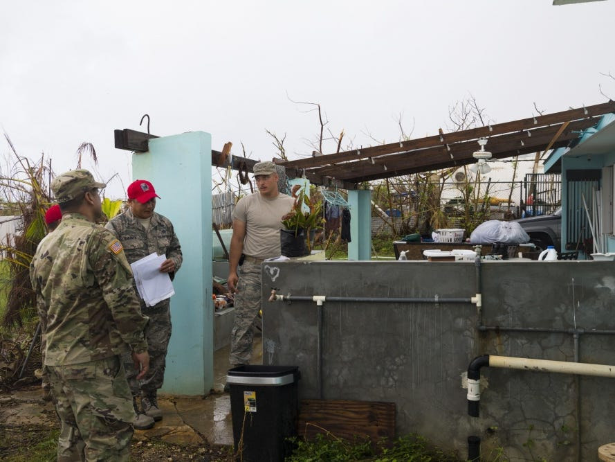 Guams Air National Guardsmen assigned to the 254th Rapid Engineer Deployable Heavy Operational Repair Squadron Engineers assess a local house for damage Nov. 8, 2018, in Saipan, Commonwealth of the Northern Mariana Islands.