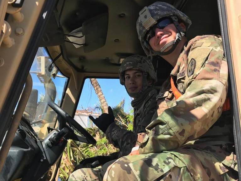 PV2 Craig Botelho and PV2 Joesph Mafnas, Guam Army National Guard, driving a truck in Chalan Kanoa today.