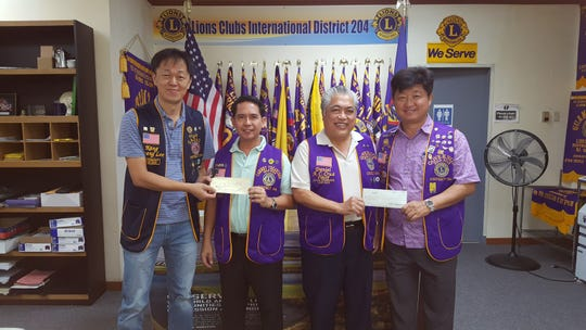 The Guam Gadao Lions Club and Past District Governor Daniel Yang both  presented $1,000 checks to Lions Clubs International District 204 to support the relief effort. On Nov. 2, Lions Clubs from region II distributed $10,000 worth of food items from funds received from Lions Club International Foundation. Guam Lions clubs donated an additional $10,000. Pictured from left: Kang Lee; president Guam Gadao; Ron Hidalgo, District 204 treasurer; Danny Cruz, district governor and PDG Yang.