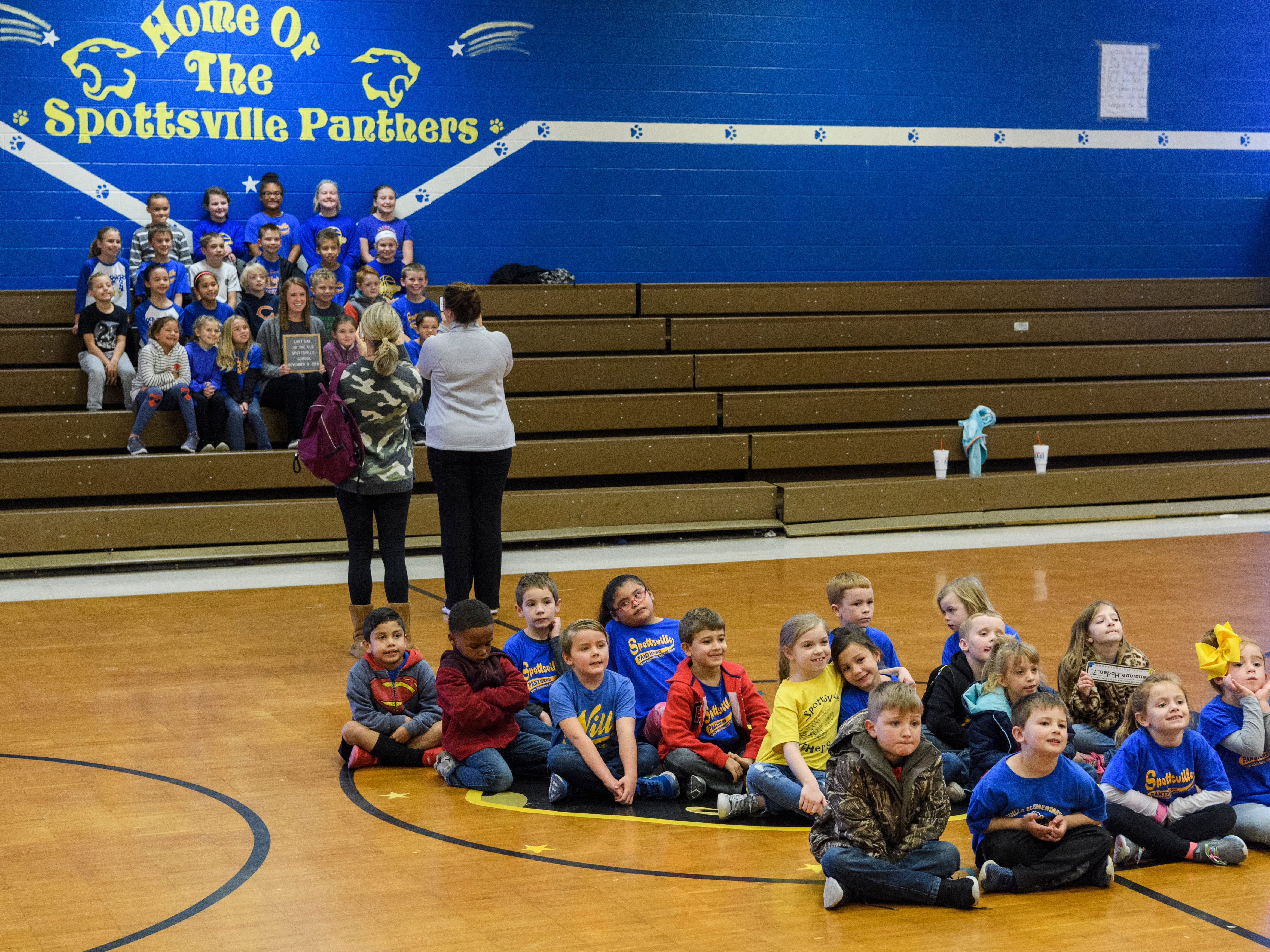 Spottsville Elementary school students take class pictures inside their old gymnasium before early dismissal starts, Friday morning, Nov. 9, 2018. They moved into the new school building, located right beside the old one, Monday morning, Nov. 12.