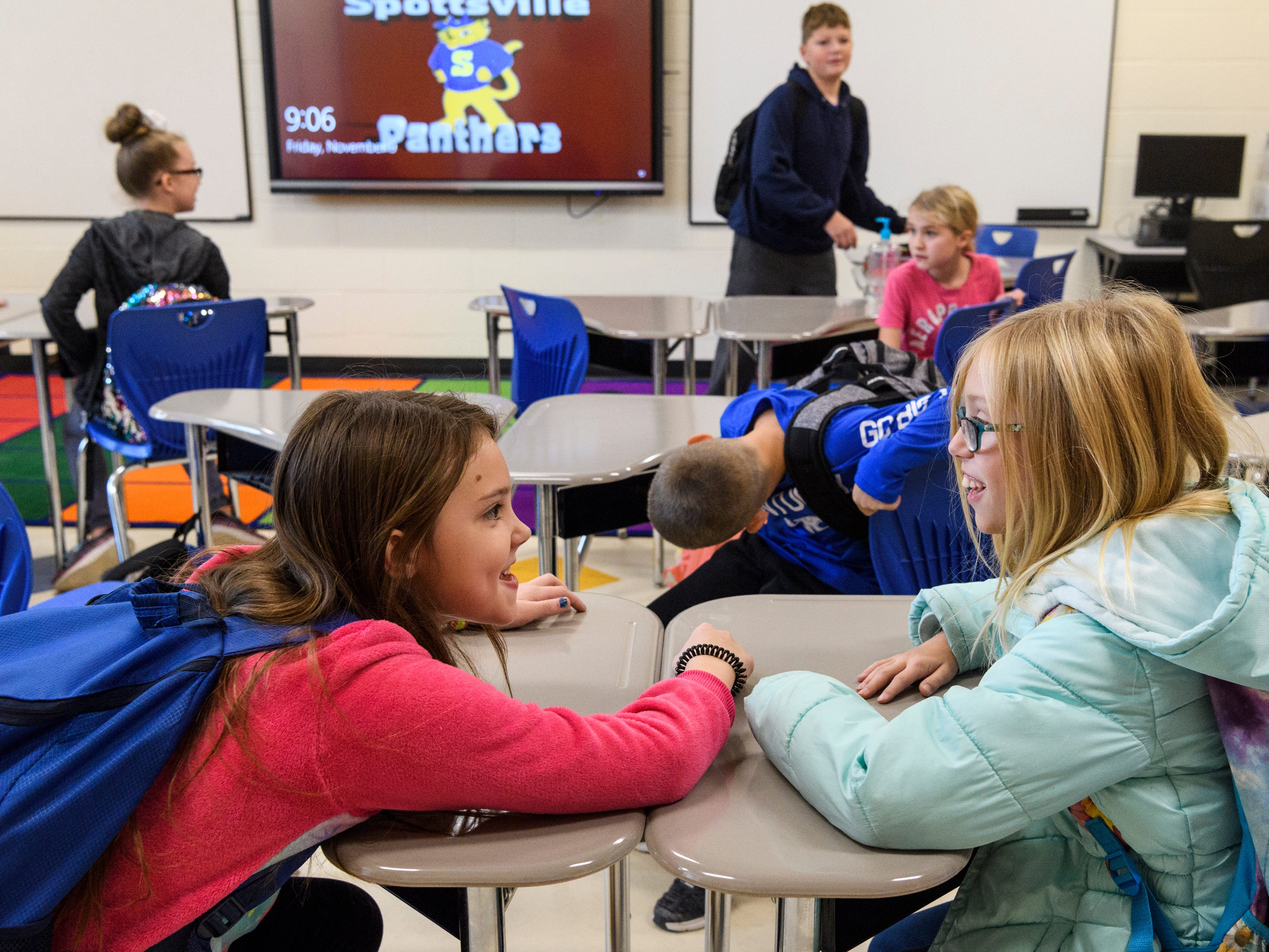 Fourth-grade students Makayla Mitchell, left, and Willow Pardue, right, chat as they get a sneak peak of their classroom in the new Spottsville Elementary School building, Friday, Nov. 9, 2018. The students used part of their early dismissal day to move items into their teacher Katie Kirkwood's classroom in preparation for the Monday, Nov. 12, move.