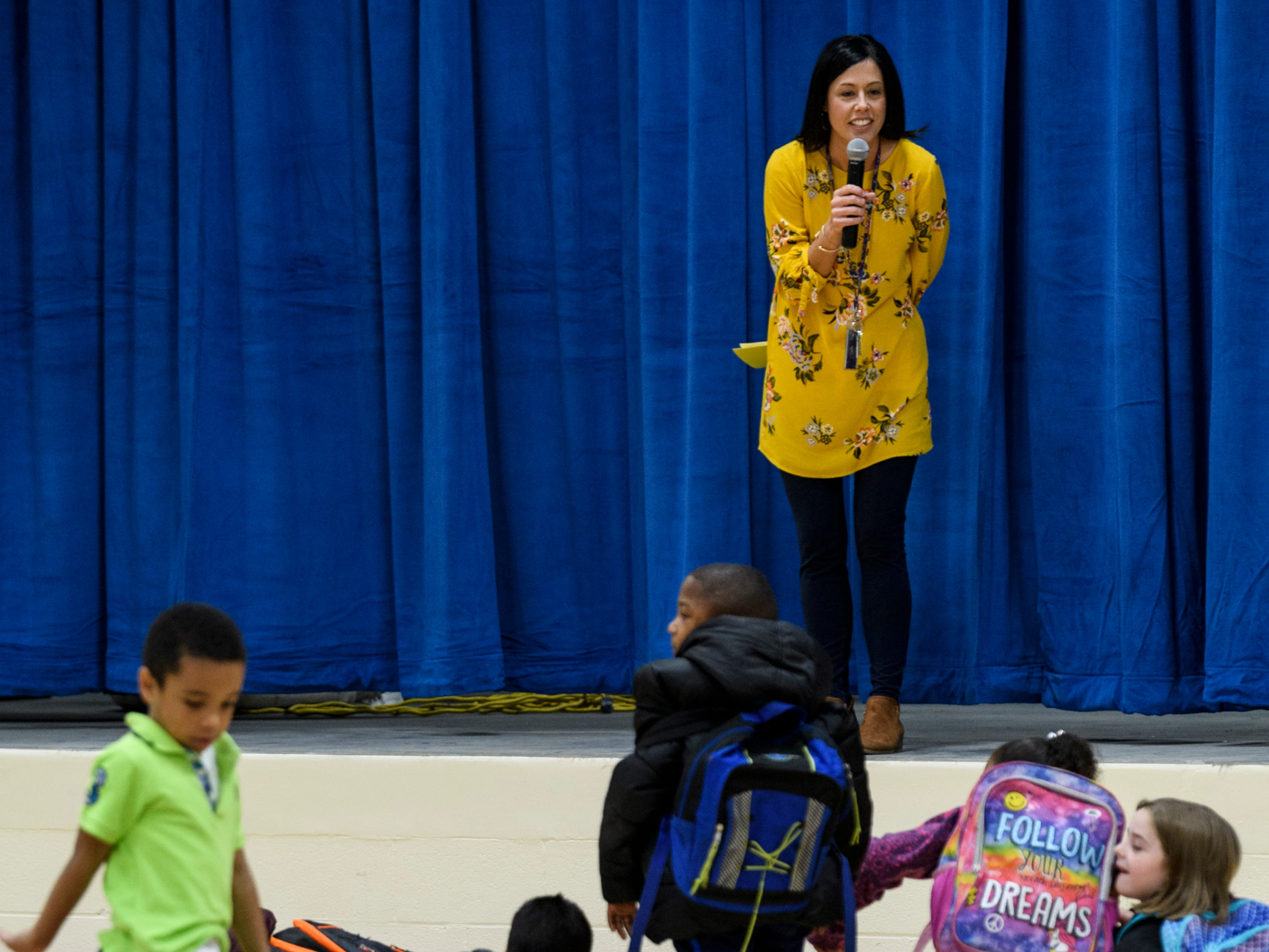 Principal Sarah Estabrook greets all the students during the morning assembly inside the gymnasium at the new Spottsville Elementary School building, Monday, Nov. 12, 2018.