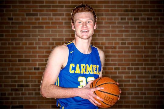 Meet 2018 IndyStar boys basketball Super Team member, John-Michael Mulloy, (33), from Carmel High School, shown here at Brebeuf Jesuit Preparatory School, on Wednesday, Nov. 7, 2018.