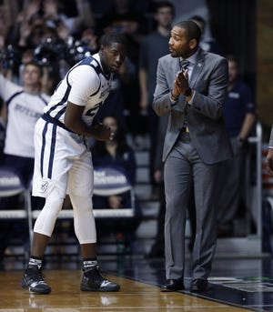Butler Bulldogs head coach LaVall Jordan talks Jerald Gillens-Butler (21)in the first half of their game at Hinkle Fieldhouse on Monday, Nov. 12, 2018.
