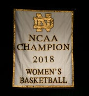 Notre Dame unveils a National Championship banner before an NCAA college basketball game against Pennsylvania Monday, Nov. 12, 2018, in South Bend, Ind.