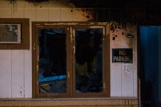Broken out windows are seen in a fire damaged unit on Monday, Nov. 12, 2018, at the former Capri Lodge, 705 2nd St, Coralville.