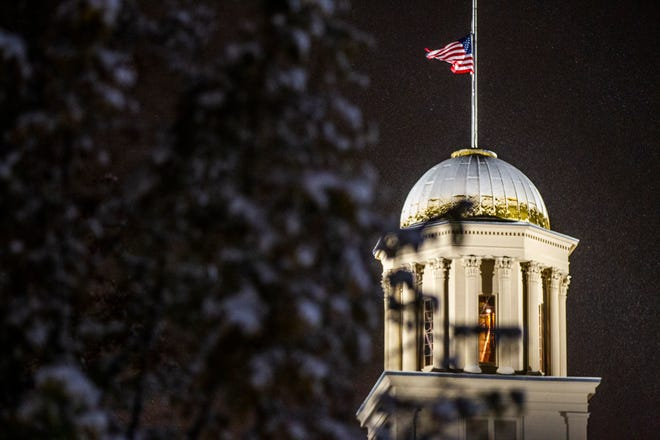 Snow builds up on the dome of the Old Capitol Building on Friday morning, Nov. 9, 2018, on the Pentacrest in Iowa City.