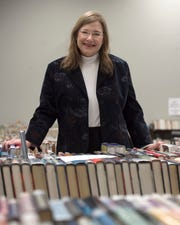 Jackson Hinds Library System Director Patty Furr stands at a book sale table in the flagship Eudora Welty library branch on State Street in downtown Jackson on Nov. 13, 2018.