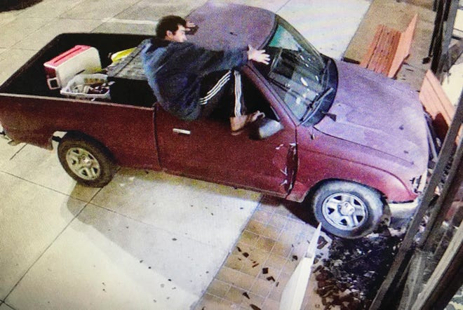 In this image taken from Harrison County surveillance video, released by the Harrison County Board of Supervisors, Keith Cavalier is seen climbing out of a Toyota Tacoma truck after it hit the east side of the courthouse in Gulfport, Miss., Saturday morning, Nov. 10, 2018. Cavalier, of Gulfport, was arrested in the incident on charges of driving under the influence and felony malicious mischief.