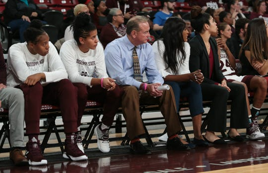Mississippi State head basketball coach Vic Schaefer sits beside Mississippi State's Andra Espinoza-Hunter (to his right)  during the third quarter. Mississippi State opened the 2018-19 season against SE Missouri State on Tuesday, November 6, 2018. Photo by Keith Warren