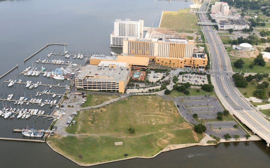 Rising seas due to climate change could overwhelm Mississippi's coastal areas in the coming decades, such as Biloxi Harbor and the nearby Golden Nugget casino, shown here. According to the U.S. Environmental Protection Agency, sea levels along the Mississippi coast are likely to rise more rapidly than other parts of the country, between 20 inches and four feet over the next century.