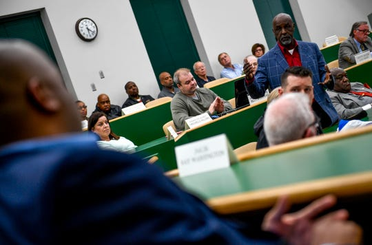 William Martin stands and speaks to school superintendent Dr. Eric Jones during a special session of the county commission meeting to vote on the funding for a new school at West Tennessee AgResearch Center in Jackson, Tenn., on Monday, Nov. 12, 2018.