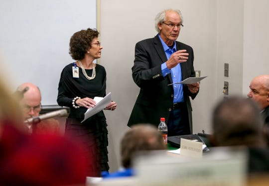 Hal Crocker, right, and Vicki Lake, left, present their plans for a new school during a special session of the county commission on Nov. 12, 2018.