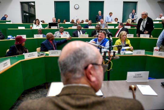Commission members speak to one another after County Clerk Fred Birmingham closed the session during a special session of the county commission meeting to vote on the funding for a new school at West Tennessee AgResearch Center in Jackson, Tenn., on Monday, Nov. 12, 2018.