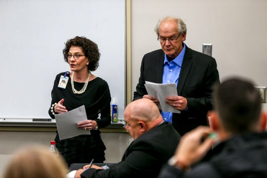 Vicki Lake, left, and Hal Crocker, right, present their plans for a new school during a special session of the county commission meeting to vote on the funding for a new school at West Tennessee AgResearch Center in Jackson, Tenn., on Monday, Nov. 12, 2018.