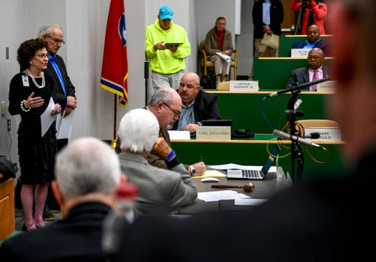 Vicki Lake, left, and Hal Crocker, behind her, present plans for a new school during a special session of the county commission meeting to vote on the funding for a new school at West Tennessee AgResearch Center in Jackson, Tenn., on Monday, Nov. 12, 2018.