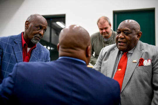 William Martin, left, and Luther Mercer, right, speak to school superintendent Dr. Eric Jones after a special session of the county commission meeting to vote on the funding for a new school at West Tennessee AgResearch Center in Jackson, Tenn., on Monday, Nov. 12, 2018.
