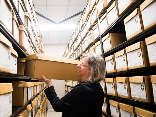 Lee Meadows Jantz, associate director of UT's Forensic Anthropology Center, pulls out a specially designed box containing a skeleton stored at the Bass Donated Skeletal Collection on Oct. 23, 2018.