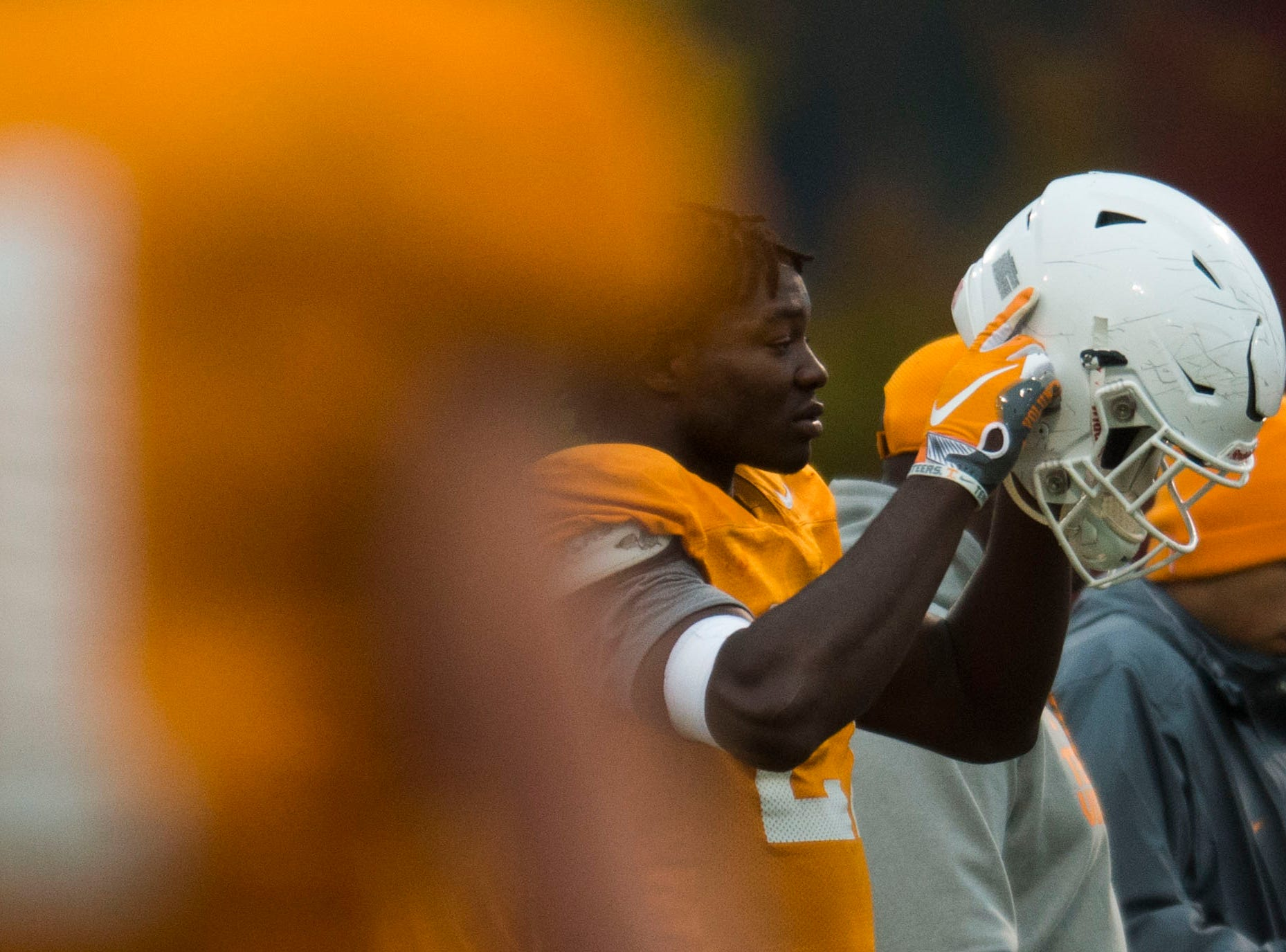 A Tennessee player puts on his helmet during a University of Tennessee football practice, Tuesday, Nov. 13, 2018.