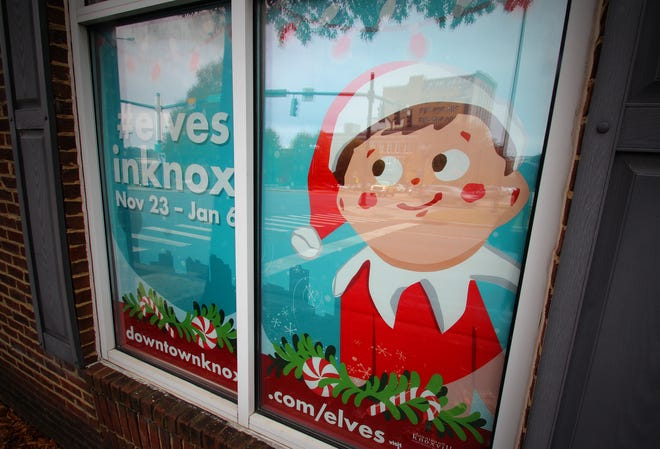 The Knoxville Visitor Center window promotes the third year of downtown Knoxville's Elf on the Shelf scavenger hunt.