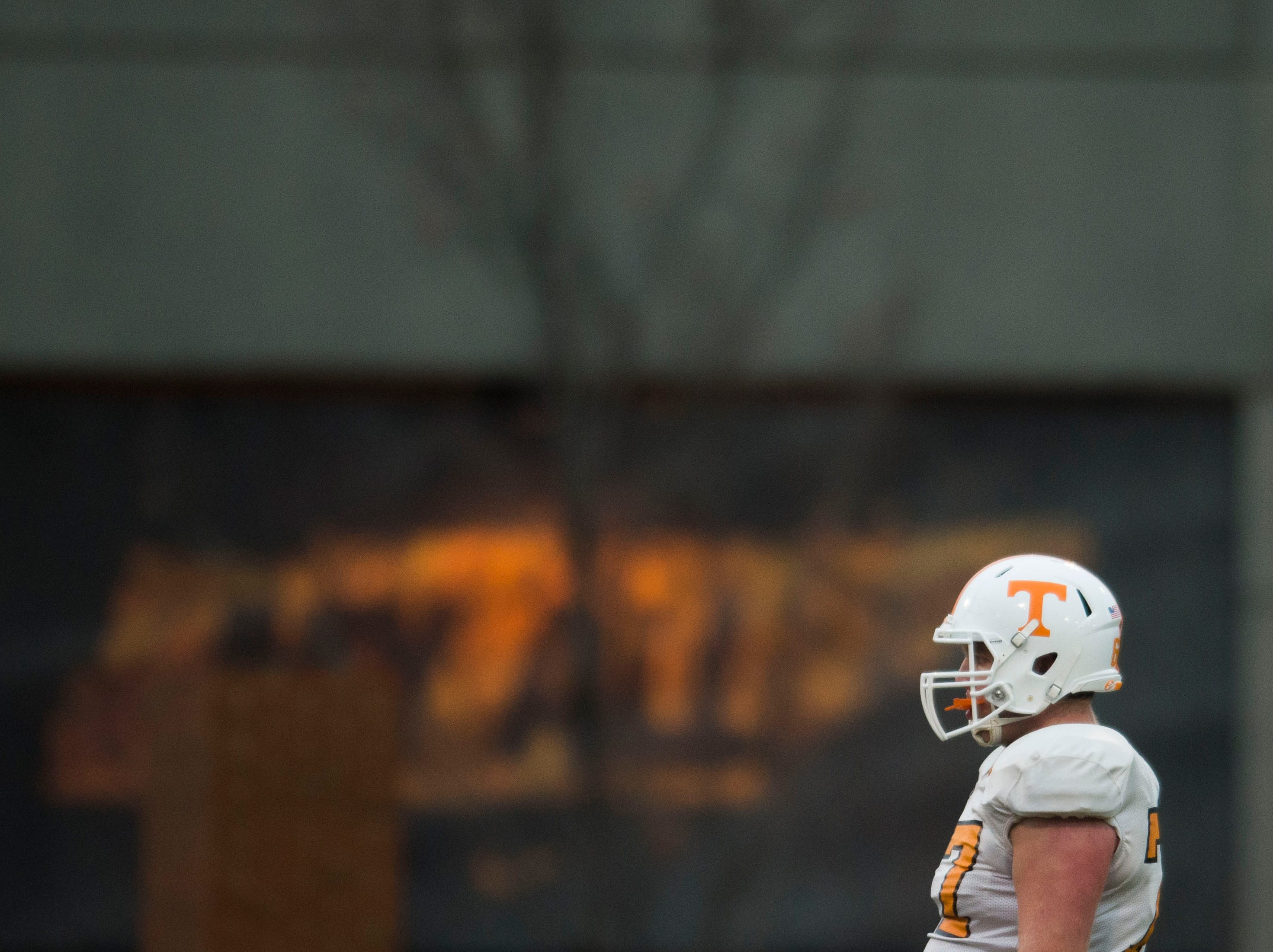A player stands on the field during a University of Tennessee football practice, Tuesday, Nov. 13, 2018.