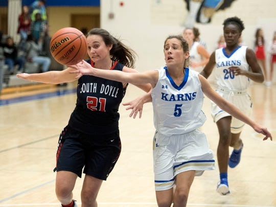 Karns' Anna Kate Reichter and South-Doyle's Maci Jones chase a loose ball during the Tennova Tip-Off Classic at Karns High School on Monday, November 12, 2018.