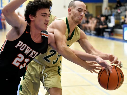 Powell's Zach Johnson and Knoxville Catholic's Connor Kuerschen fight for control of the ball during the Tennova Tip-Off Classic at Karns High School on Monday, Nov. 12. Powell got the better of it, 23-15, in two six-minute quarters of play.