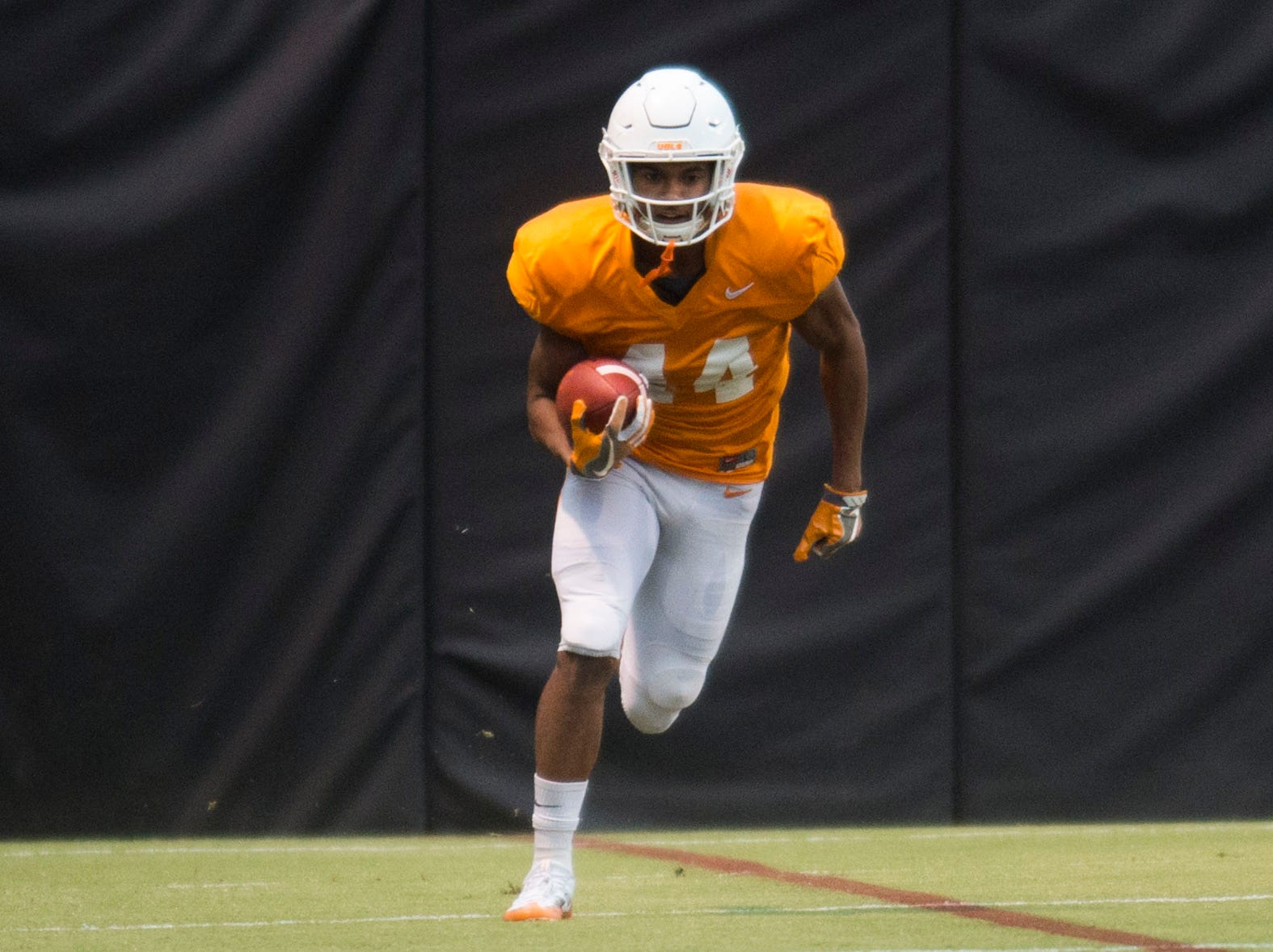 Tennessee defensive back Cheyenne Labruzza (44) runs the ball during a University of Tennessee football practice, Tuesday, Nov. 13, 2018.