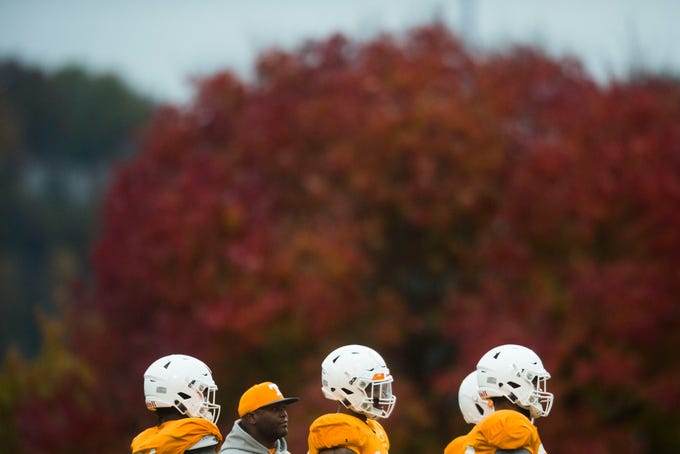Players stand on the field during a University of Tennessee football practice, Tuesday, Nov. 13, 2018.