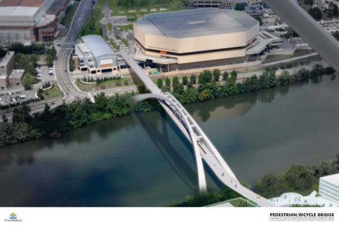 A concept drawing of a pedestrian bridge connecting South Knoxville to the University of Tennessee's Thompson- Boling arena.