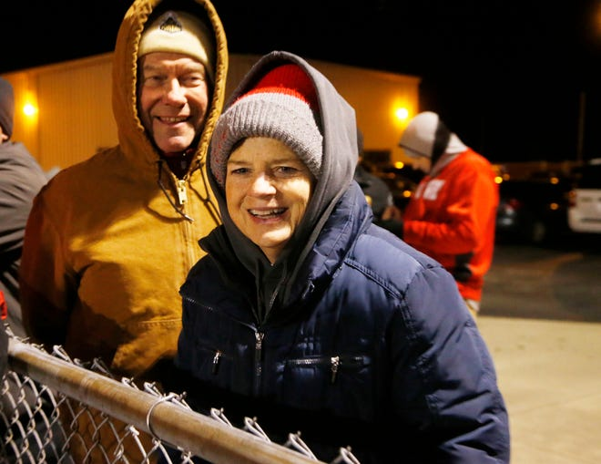 """Marion Vruggink and her husband Jim take in the West Lafayette vs Brebeuf football regional game Friday, November 9, 2018, at Gordon Straley Field in West Lafayette. Known as """"Mrs. V"""" to countless students athletes at West Lafayette, Marion Vruggink retired recently after serving for for over thirty years as the school's athletic trainer."""