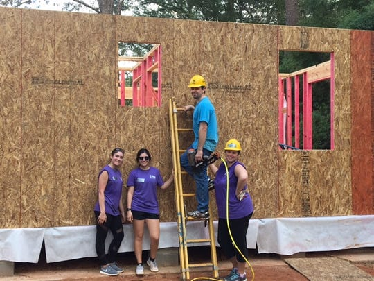 Habitat for Humanity builds are a favorite volunteer activity for Home Bank staff members.