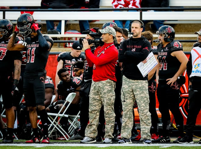 UL coach Billy Napier, in black top standing next to kicker Calvin Linden (41), updated the Cajuns' injury situation Monday.